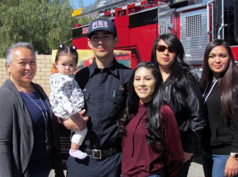 Glenn Lindsey, Soboba Fire Department's newest employee, poses with his family at a recognition ceremony on Feb. 25. From left, his grandmother Rosemary Morillo, Lindsey holding his daughter Avareign, his fiancée Glori Beltran, his mother Michelle Morillo and his aunt Anita Morillo