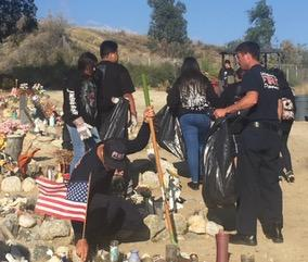 Members of the Soboba Youth Council, TANF and the Soboba Fire Department clean and place American flags on the graves of veterans at the Soboba Cemetery