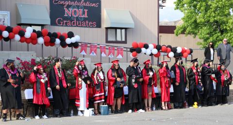 All 13 seniors from Noli Indian School get ready to turn their tassels after being certified as official graduates of the Class of 2021 by Principal Donovan Post and Tribal Council Vice Chairwoman Geneva Mojado (at right)