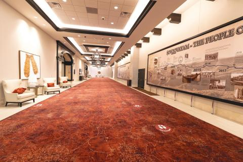 The hallway of the Soboba Casino Resort Event Center includes a timeline of the Soboba Band of Luiseño Indians. Floor signage has been added to provide guidelines for social distancing