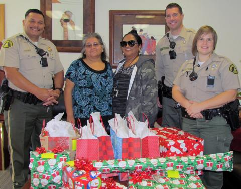 Members of the Riverside County Sheriff's Department stepped up to help Santa deliver gifts for Soboba Tribal TANF families. From left, Deputy Antonio Soto, Marian Tortez, Virginia Duenaz, Deputy Trent Tully and Deputy Kelly Looney