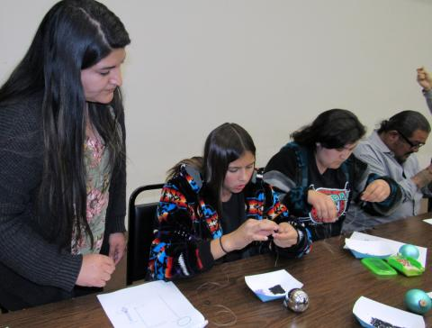 Mercedes Estrada, left, instructs participants in the Soboba Tribal TANF Christmas ornament beading class held in December. Photo courtesy of Soboba Band of Luiseño Indians.