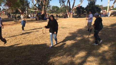 Tanya Rivera practicing throwing the hoop for the hoop and stick game at the recent AILOTT conference and cultural awareness day in Long Beach