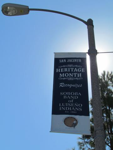 A light pole banner shows Soboba's support of Heritage Month