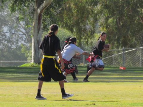 Flag football players have a good time during the Intertribal Turkey Bowl at the Soboba Reservation on Nov. 21