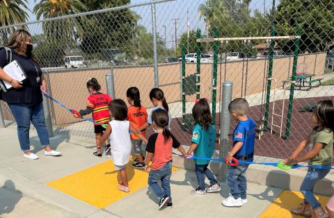 Soboba Tribal Preschool students are led away from the building during a practice fire drill Aug. 24