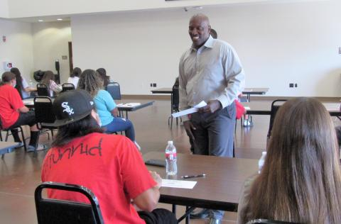 Soboba Tribal Administration's Financial Analysis Manager Lenell Carter interacts with Soboba youth during the first of five Financial Literacy 101 classes he taught