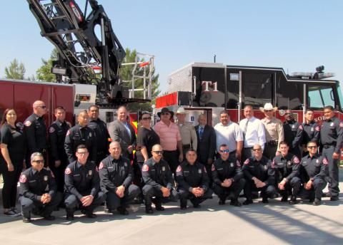 Members of Soboba Fire, Soboba Tribal Council and other dignitaries stand in front of the department's new Tiller Truck during the official opening of the new facility on June 7