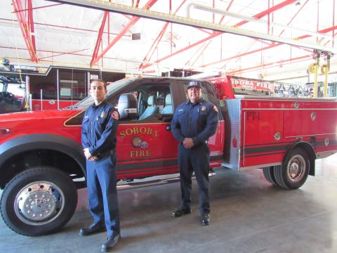 Firefighter Glenn Lindsey, left, and Fire Captain Jacob Briones stand beside the patrol truck recently acquired by the Soboba Fire Department