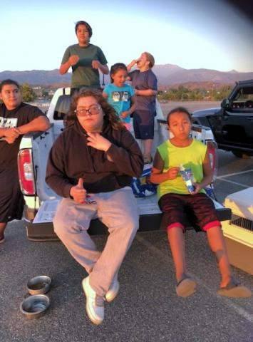 Members of the Briones Venegas families tailgated at the old Soboba Casino parking lot while waiting for the fireworks show to start on July 4