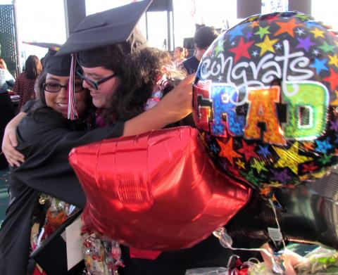 Noli Indian School valedictorian Larissa Lugo, left and salutatorian Ciara Herbert congratulate each other after their commencement ceremony on June 7 at the Soboba Outdoor Arena