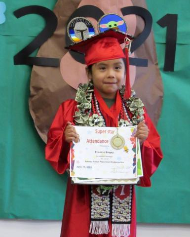 """Francis Begay's interest in Disney's """"The Mandalorian"""" series was evident in the sash and mortarboard he wore with his kindergarten graduation gown. He was the only student who received a Perfect Attendance award from the Soboba Tribal Preschool"""