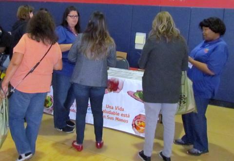 Anna Virgen and Hosea Jones, with Riverside County's Nutrition Education and Obesity Prevention Program, talk to guests at Soboba's Community Health Fair on March 8