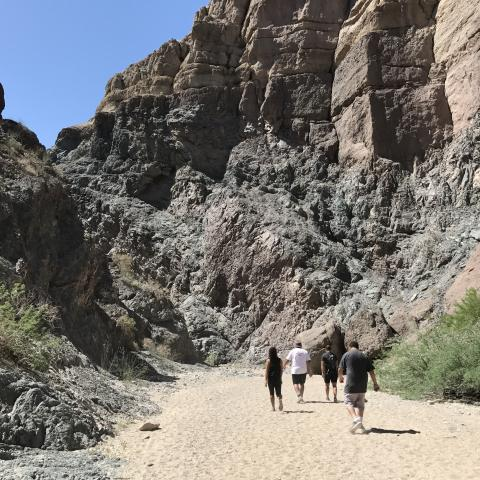 Hikers enjoy the rock formations during a walk through Mecca Hills Painted Canyon/Ladder Canyon in Desert Hot Springs on April 15