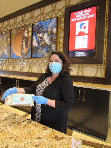 Michelle Woodfin from Soboba Casino Resort hotel services shows one of the wellness kits containing hand sanitizer and face masks that each guest receives upon check-in