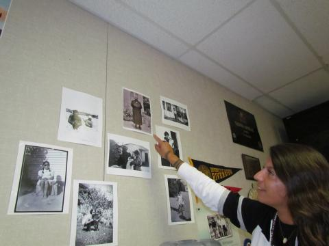 Noli Indian School teacher Tashina Ornelas keeps photos that depict her family's history on the classroom wall where she teaches Native history, literature and culture classes