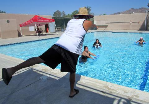Instructor Daniel Mazza gives directions to water aerobics participants at the Soboba Sports Complex pool on Sept. 3