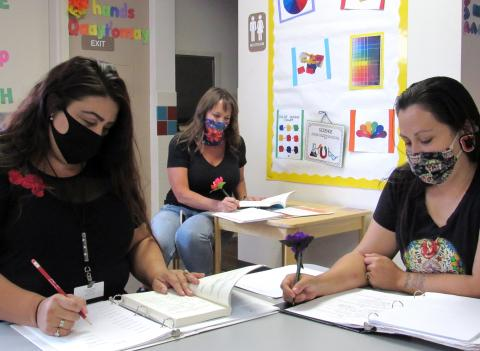 About 10 Soboba Tribal Preschool staff members are learning the Luiseño language during weekly classes that began in June and will last until the end of the year. From left, teacher Ana Garcia, director Dianne King and teacher Melissa Arviso review their notes after a recent class on August 12
