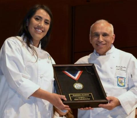 Graduate Nanisha Ramos is congratulated by Chef David Avalos for being Riverside City College Culinary Academy's class valedictorian on April 12