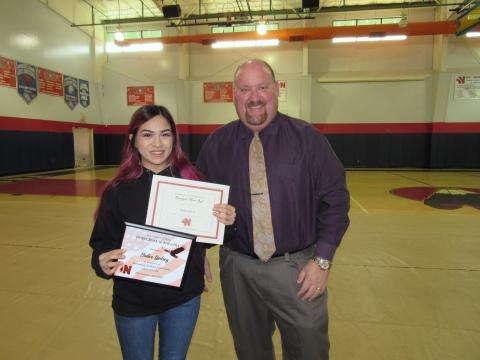 Noli Indian School Principal Donovan Post congratulates senior Bailee Lindsey for earning a 4.0 GPA, which put her on the Principal's Honor Roll.