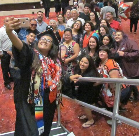 Noli Indian School Valedictorian takes a selfie with family and friends after her graduation on June 5 at the Soboba Casino Resort Event Center in San Jacinto