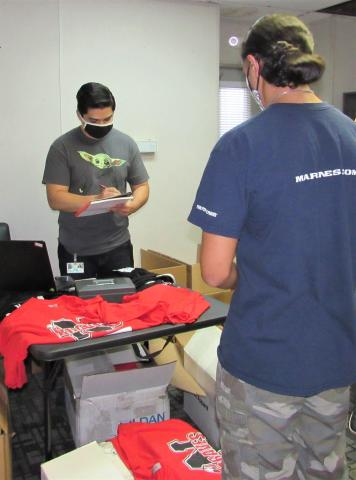 Incoming senior Frank Moreno made his way to the various stops to complete his registration on July 29