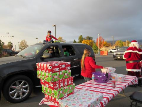 A drive-thru Christmas party was held for Tribal Members at the Soboba Sports Complex on Dec. 12. There was holiday, sweet treat giveaways and Santa presented each child with a gift