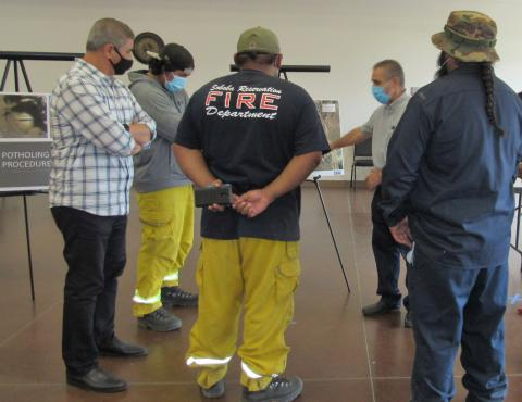 ERSC Project Engineer Reza Toorzani explains the water pipeline replacement project while ERSC Project Manager Moe Ahmadi, at far left, and Soboba Fire Department employees listen during a community outreach event on Oct. 6