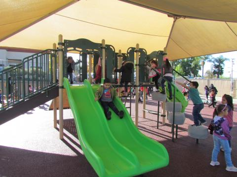 The new upgraded playground was opened for 82 students of the Soboba Tribal Preschool. With so many options, the children were excited to try everything at least once. The Poly Double Wave Slide in lime green was a favorite