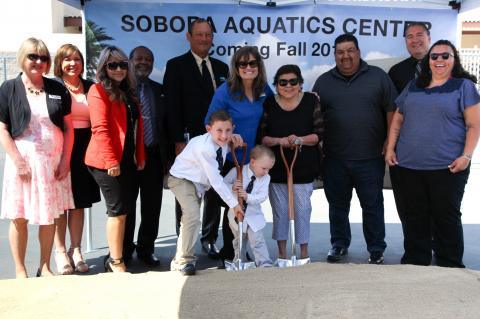 A ceremonial ground breaking for the Soboba Aquatics Center at San Jacinto High School brought smiles to the participants as School Board Member Deborah Rex's grandsons Jared and Logan Hollist pitched in to help. From left, Trica Ojeda, Diane Perez, Jasmin Rubio, Willie Hamilton, John Norman, Deborah Rex, Rose Salgado, Isaiah Vivanco, Michael Castello and Kelli Hurtado