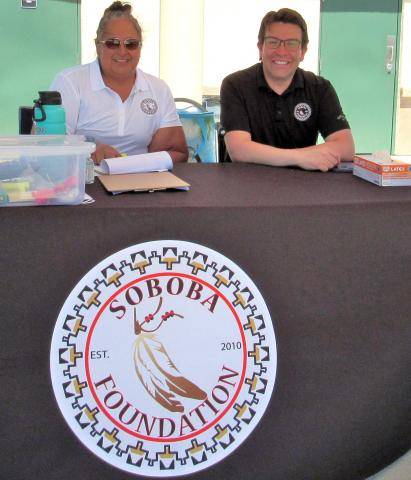 Soboba Foundation President Dondi Silvas and Sponsorship Coordinator Andrew Vallejos staff the check-in table for produce box pickups on June 10 at the Soboba Sports Complex