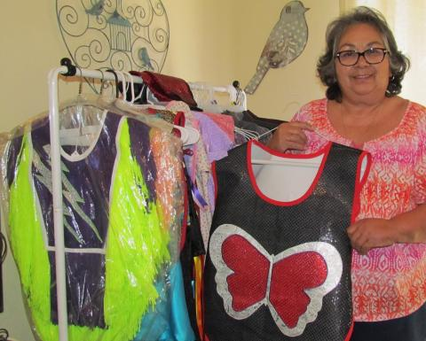 Gloria Vivanco with some of the many regalias she has created