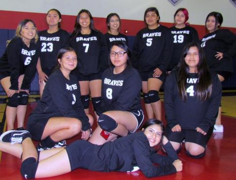 Noli Indian School's Lady Braves volleyball team after their win against Hemet's River Springs Charter School team on Sept. 25.