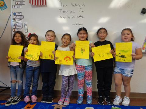 Kindergarten students at Soboba Tribal Preschool hold up letters they signed to be sent to veterans. From left, Aniyah Brittain, Monica Rivera, Samuel Venegas, Candace Devore, Tuupash Arviso, Sovova 'Iswut Rodriguez and Aydreean Rose Garcia