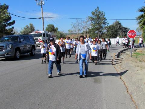 Soboba Elder Marian Chacon, left, and her friend Rachel Miranda lead the Elders/Youth Walk and War on Drugs Walk at the Soboba Indian Reservation on March 25